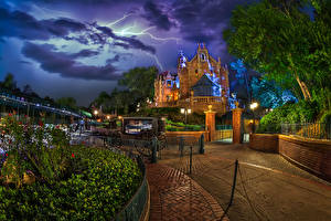 Pictures USA Disneyland Park Houses California Anaheim Design Night time Carriage Street lights Fence Lightning bolts Nature