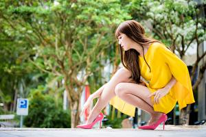 Photo Asian Bokeh Brown haired Sit Hands Legs Stilettos young woman