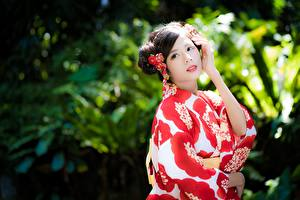 Image Asiatic Blurred background Brunette girl Glance Hands Kimono Girls