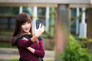 Pictures Asiatic Smartphones Selfie Bokeh Brown haired Hands Glance Girls