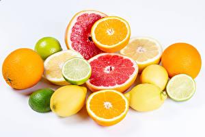 Fotos Zitrusfrüchte Limette Zitrone Grapefruit Apfelsine Weißer hintergrund das Essen