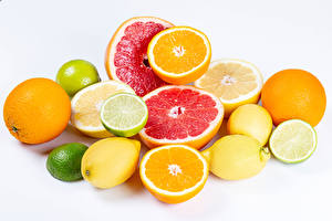 Bureaubladachtergronden Citrusvruchten Limoen Citroenen Grapefruit Sinaasappel Witte achtergrond