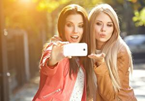 Pictures Izabela Magier Selfie Blonde girl Brown haired Beautiful Two Smartphones Young woman Girls