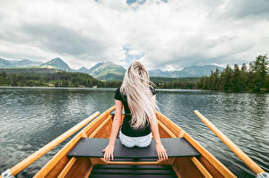 Pictures Lake Boats Sit Back view Blonde girl Hands female