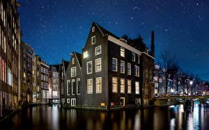 Bilder Niederlande Amsterdam Gebäude Himmel Stern Nacht Kanal Städte