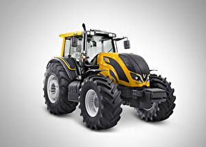 Bilder Traktor Gelb Grauer Hintergrund Valtra BH