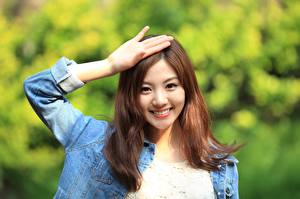 Photo Asian Gesture Brown haired Glance Smile Hands Blurred background Korean Girls