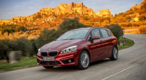 Desktop wallpapers BMW Moving Red Metallic Hatchback, 220d xDrive, Active Tourer, 2014 Cars
