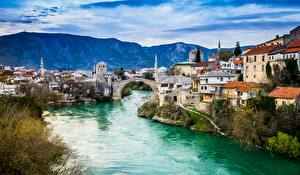 Wallpapers Bosnia and Herzegovina Rivers Bridges Houses Mountains Mostar Cities pictures images
