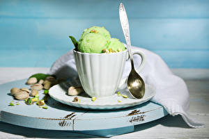 Image Ice cream Nuts Cup Spoon Balls Yellow green Food