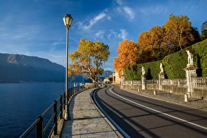 Images Italy Mountains Lake Alps Waterfront Trees Street lights Lago di Como Nature