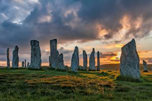 Wallpaper Scotland Stones Sunrises and sunsets Clouds Grass Callanish Stones