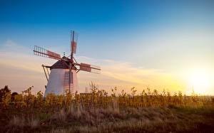 Pictures Sunrise and sunset Grass Windmill Nature