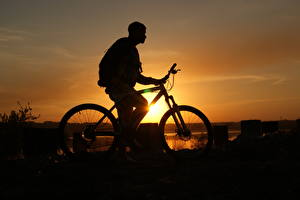 Wallpapers Sunrises and sunsets Men Bicycle Side Silhouette Flowers pictures images
