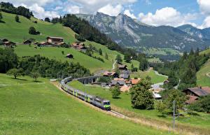Bilder Schweiz Haus Eisenbahn Berg Alpen Dorf Zweisimmen