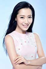 Bakgrunnsbilder Asiater Farget bakgrunn Brunette jente Blikk Smil Hender Buy Bin, Chinese Unge_kvinner