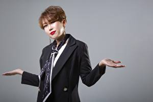 Image Asiatic Gray background Brown haired Staring Hands Necktie Korean young woman