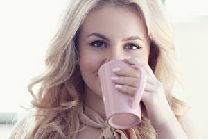 Pictures Eyes Blonde girl Staring Cup Hands female