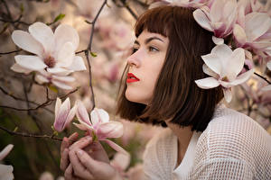 Images Flowering trees Magnolia Brown haired Branches Katharina young woman Flowers