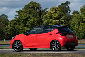 Wallpapers Toyota Red Metallic Side Yaris Hybrid UK-spec, 2020 automobile