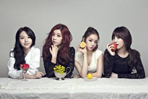 Image Asian Berry Strawberry Grapes Apples Lemons Brown haired Brunette girl Sit Glance Hands Redhead girl young woman