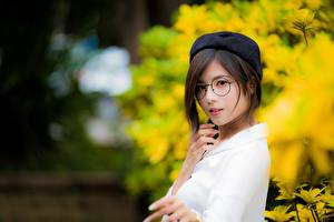 Pictures Asian Blurred background Beret Brown haired Staring Glasses Hands young woman