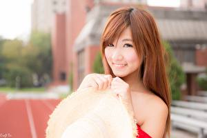 Images Asiatic Bokeh Redhead girl Staring Smile Hands Hat young woman