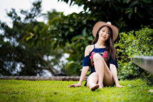 Pictures Asiatic Sit Legs Hat Staring female
