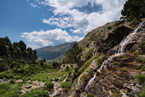 Pictures Mountain Waterfalls Cliff Streams Stream Trees Clouds Pyrenees Nature