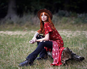Pictures Redhead girl Sit Frock Jeans Hat Staring young woman