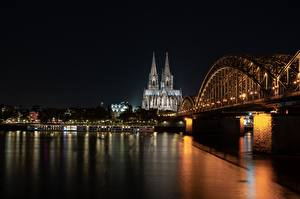 Photo River Bridge Cathedral Cologne Germany Night time Cologne cathedral, Rhine river Cities