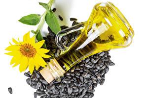 Hintergrundbilder Sonnenblumen Sonnenblumensamen Weißer hintergrund Flaschen Öle Lebensmittel