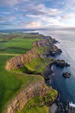 Hintergrundbilder Vereinigtes Königreich Küste Felsen Wolke Antrim, Northern Ireland Natur