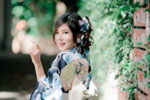 Images Asian Bokeh Hands Brunette girl Staring Smile young woman