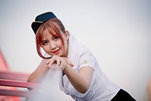 Wallpapers Asian Bokeh Stewardesses Glance Smile Hands Redhead girl young woman