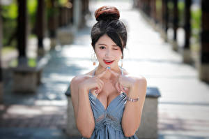 Pictures Asian Gesture Bokeh Brunette girl Décolletage Hands female