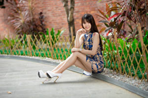 Pictures Asian Sitting Legs High heels Dress Smile Glance Girls