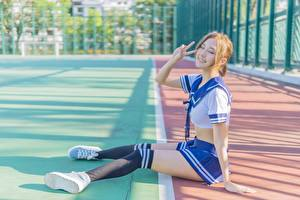 Picture Asian Skirt Brown haired Smile Hands Sit Legs Knee highs Schoolgirl Uniform young woman
