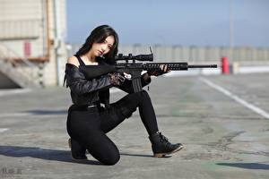 Picture Asiatic Sniper rifle Asphalt Brunette girl Posing Jacket Girls