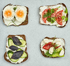 Desktop wallpapers Butterbrot Bread Tomatoes Cucumbers Vegetables Gray background Oil Eggs Food