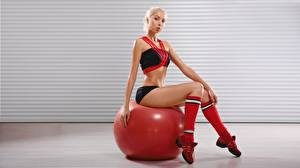 Pictures Fitness Ball Sitting Blonde girl Legs Glance Girls