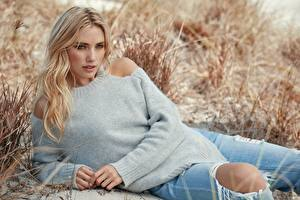 Wallpaper Grass Blurred background Blonde girl Esting Sweater Hands Jeans young woman