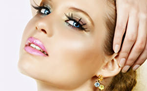 Pictures Lips Eyes Fingers Face Glance Makeup Earrings Manicure young woman