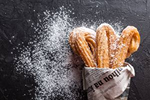 Pictures Pastry Powdered sugar Newspaper churros