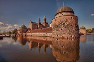 Bilder Schweden Burg Fluss Brücke Vadstena Castle Städte