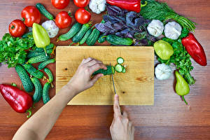 Wallpaper Vegetables Tomatoes Bell pepper Cucumbers Garlic Wood planks Cutting board Hands