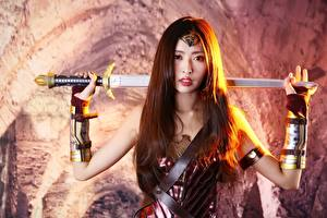 Wallpaper Warrior Blurred background Brown haired Staring Hands Swords Armour Costume play young woman