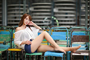 Pictures Asiatic Sitting Legs Shorts Blouse Glance Brown haired Girls