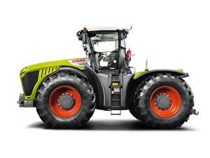 Bilder Traktoren Seitlich Weißer hintergrund Claas Xerion 5000 Trac, 2014
