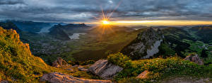 Wallpaper Switzerland Mountain Sunrise and sunset Alps Sun Schwyz